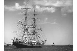 Tall Ship Unicorn with Brant Point Light in the background, circa 1950.