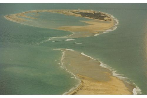 Aerial view of Great Point lighthouse isolated by nor'easter, January 1992