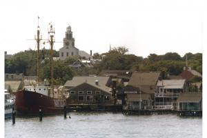 The Nantucket Lightship docked at Straight Wharf, as seen from the harbor.
