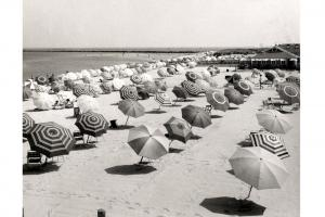 View of Cliffside Beach with umbrellas, circa 1950.