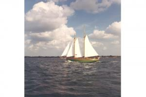The schooner Halcyon, under full sail, circa 1960.