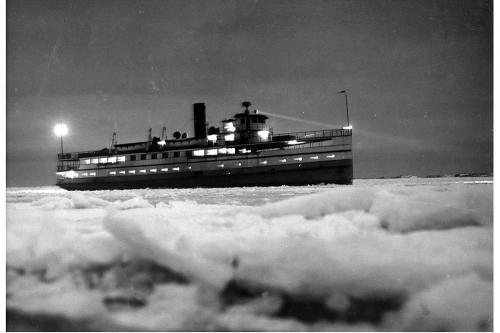 Steamship Nobska approaching the wharf at night, January 1961.
