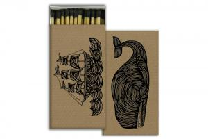 Brown matchbox with black, decorative whale and ship design